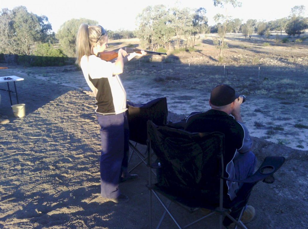 "Lacey shooting ""Fox Targets with David checking the accuracy."
