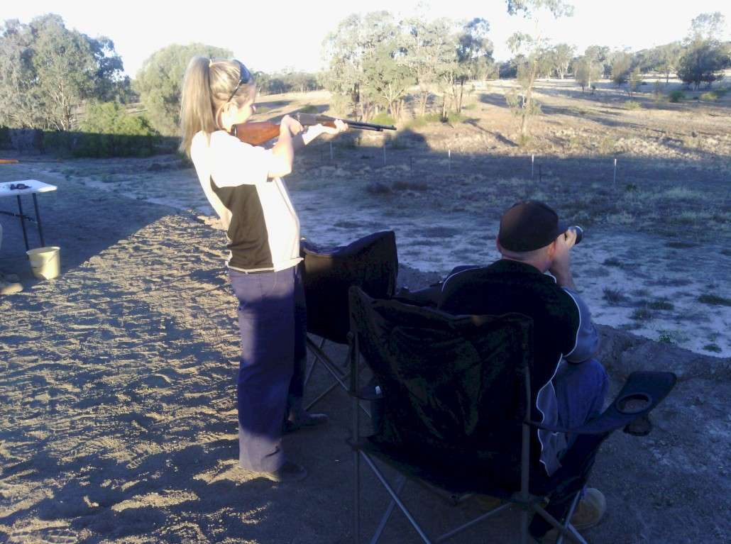 """Lacey shooting """"Fox Targets with David checking the accuracy."""