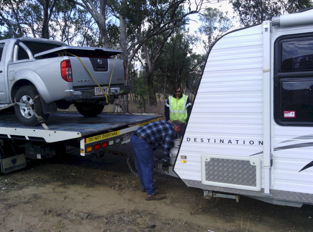 Hooking up the caravan to the tow truck.
