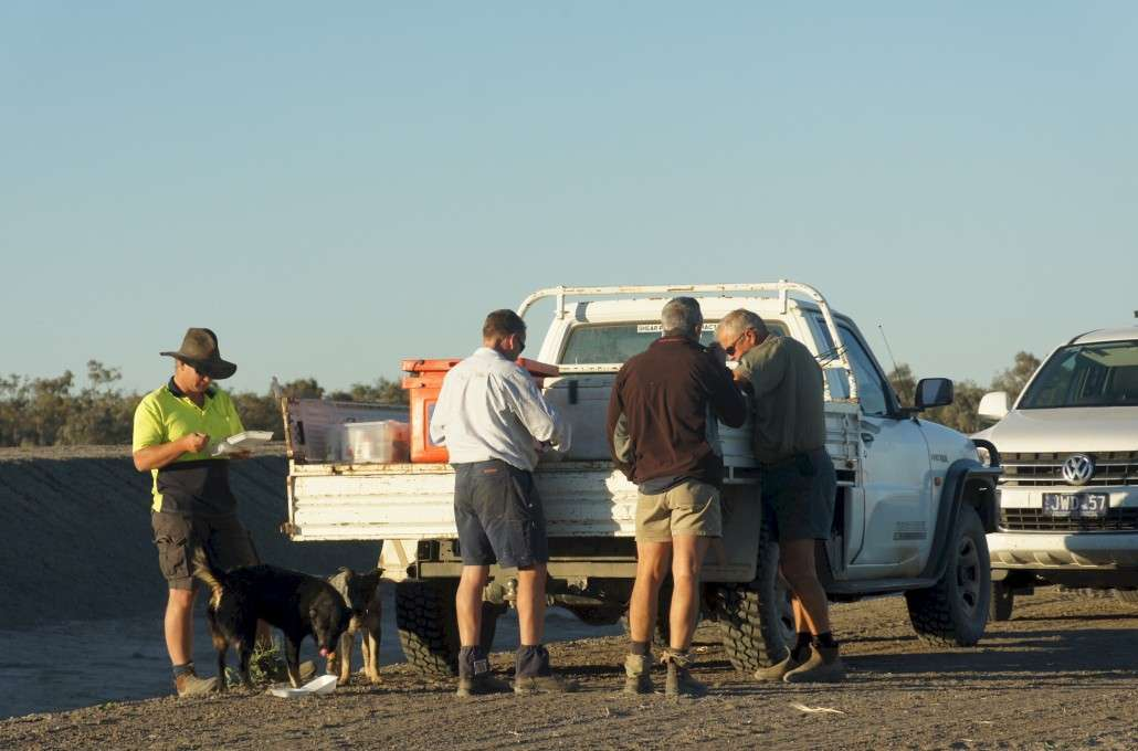 Jason, Dipper, Dave and John eating dinner from the back of the Ute.