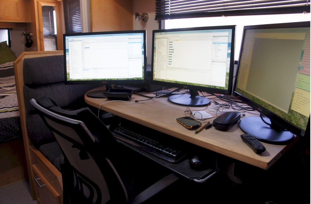 """The """"Office"""" now set up in the caravan. A lot cooler with the air conditioner and not covered in dust."""