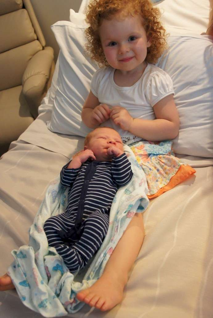 """Elliana is taking her role of """"Big Sister"""" very seriously. She keeps commenting on how small everything is on Luke."""